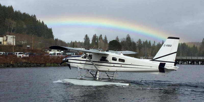 Seaplane with a rainbow in the background
